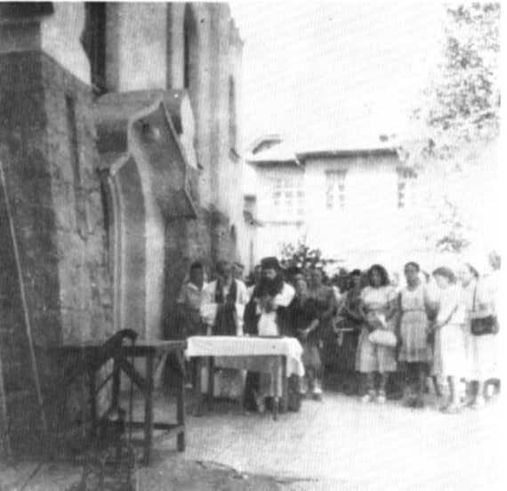 Bishop John serving with Fr. David Chevchenko, August 30, 1948, Sindao, China. When the Soviet administration ordered the church to be locked, Bishop John did not hesitate to serve Liturgy in front of the church. In this particular picture he is serving a molieben