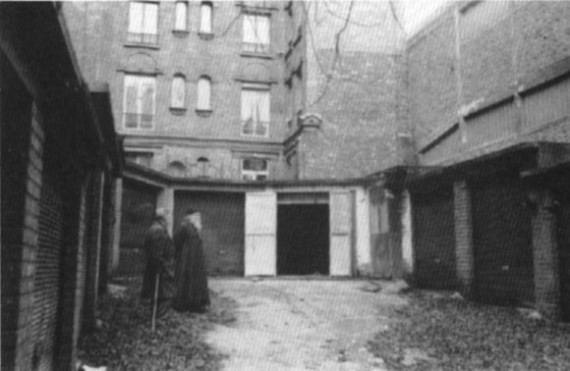 Archbishop John's Paris 'Cathedral', actually a garage church, in the 1950's. Before it stand Fr. Mitrophan, a disciple of Archbishop John