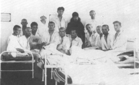 Hieromonk John in the Bitol Seminary Infirmary with sick and homeless seminarians, for whom he was the most colorful figure during all their seminary years