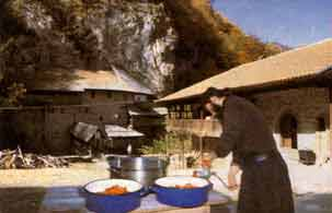 Serb monk making tomato juice - getting ready for the winter