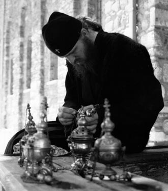 Cleaning the censers, Visoki Decani Monastery monk, Serbia