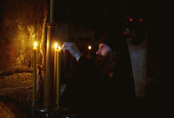 Lighting a candle, Visoki Decani Monastery monk, Serbia