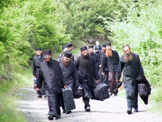 Pilgrimage of serb monks from Raska and Prizren Monasteries in Serbia, to central Serbia and Belgrade, up the hill to the bus at Koncul