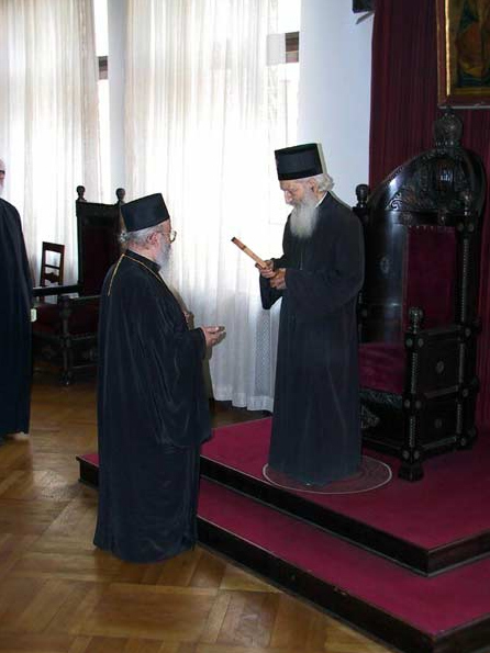 Serb Bishop Artemije gives to Serb Patriarch Pavle a woodcarved cross as a gift of the monks from RAska and Prizren Diocese, Serbia