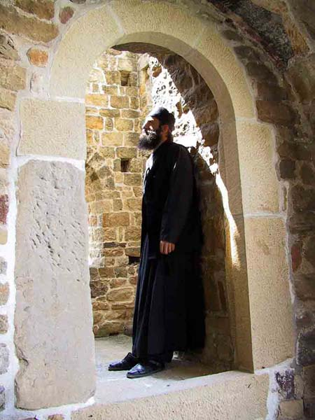 Serb monk meditating in an old monastery tower, Djurdjevi Stupovi Monastery, Serbia