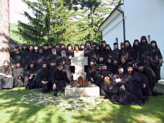 Serb monks around the tomb of St. Justin of Celije, Serbia