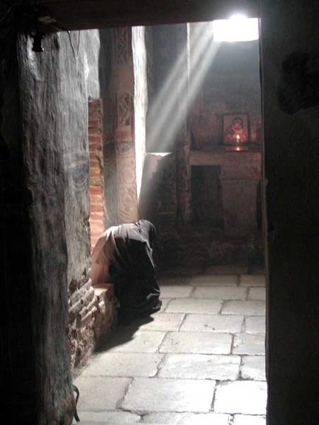Serb nun praying at Gracanica Monastery, Serbia