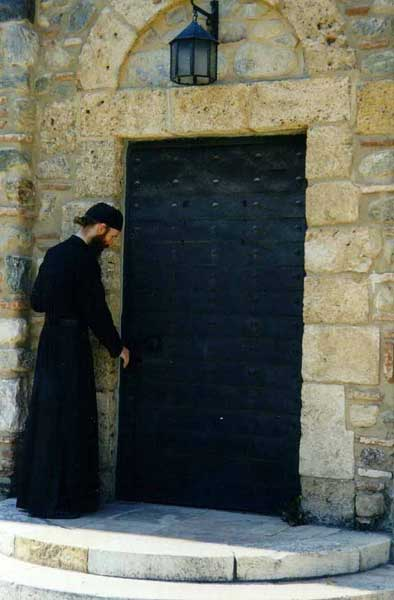 At the door of the old refectory, Visoki Decani Monastery monk, Serbia