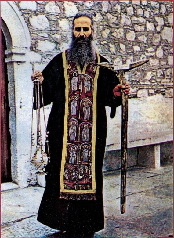 Waring the epitrachelion of Blessed David, also holding his censer and his praying stick (1976)