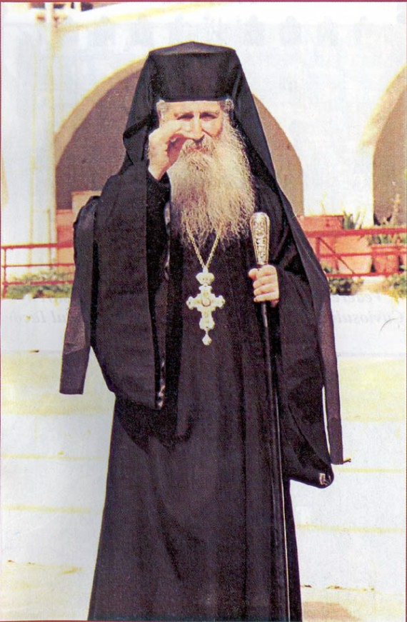 Abbot Jacov in the monastery yard, giving his blessing