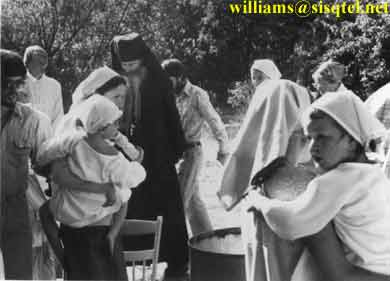 During the baptismal procession at the old Saints Adrian and Natalie church in Etna, 1981 - Copyright � The Blessed Seraphim Hermitage
