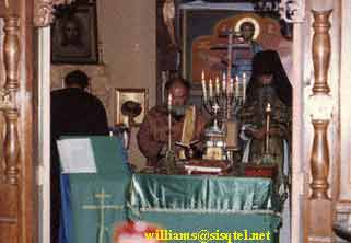 From L. to R - Fr. Herman, Fr. Deacon (now Priest) Vladimir Anderson, and Bl. Seraphim serving in the old church at the Saint Herman of Alaska Monastery - Copyright � The Blessed Seraphim Hermitage