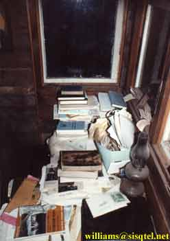 Blessed Seraphim's desk with books and a kerosene lamp - Copyright © The Blessed Seraphim Hermitage