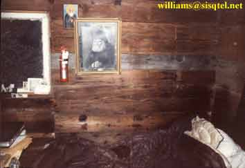 The interior of the cell and Blessed Seraphim's bed. One may observe that where Bl. Seraphim's head would lay the wall is stained from the oil off his head - Copyright � The Blessed Seraphim Hermitage