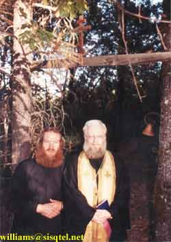 Fr. Deacon Lawrence and Fr. Alexey Young standing at the gateway to Blessed Seraphim's cell - Copyright � The Blessed Seraphim Hermitage