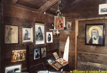 The icon corner, where one may observe icons of Christ, the Theotokos, Blessed Xenia, St. Seraphim, the Cross, St. Herman, Sts. Methodius and Cyril - Copyright � The Blessed Seraphim Hermitage