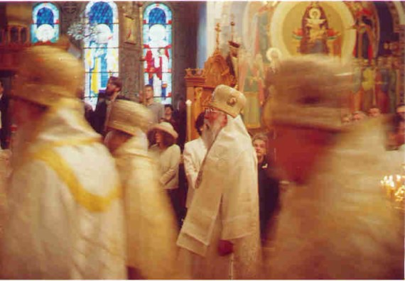1. Before the Vigil - As the hierarchs enter, OCA Bishop Tikhon of San Francisco pauses long enough to be captured on film in the main monastery chapel. Above, stained glass windows and icons filled the walls of the chapel. One could easily spend an entire service just staring at the saints