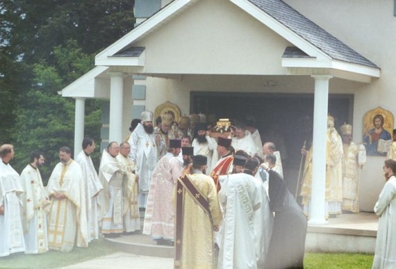 17. Procession and Divine Liturgy - Priests prepare to carry the relics from the outdoor Vigil chapel to the indoor site for Liturgy. The priests were lead by the deacons and followed by the hierarchs