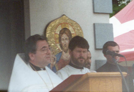 6. Vigil - Reading the proclamation of the holy synod of the Orthodox Church in America, regarding the glorification of St. Raphael, is V. Rev. Fr. Robert Kondratick, Chancelor of the OCA. Standing next to him is Fr. Deacon John Hopko. This is at the very beginning of Vigil service, just after all the clergy and the relics have processed in