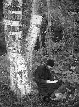 Russian monk taking notes