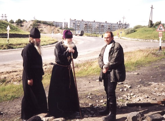 Russian Bishop talking to a lay man and a father